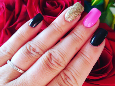 Multi-coloured nails, including black, bright pink and gold sparkles