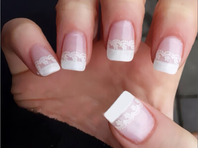 Gel nails with white lace art that is fit for a bride